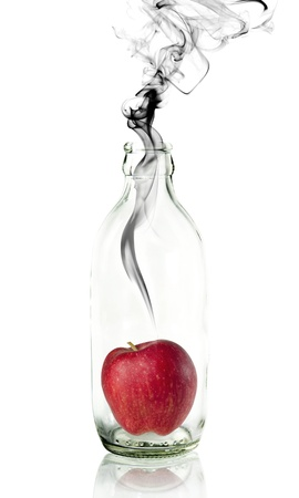 apple in Glass bottle with concept smoke Stock Photo - 12605077