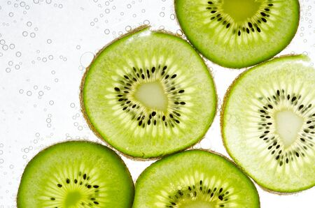 Slice kiwi fruit on white background photo