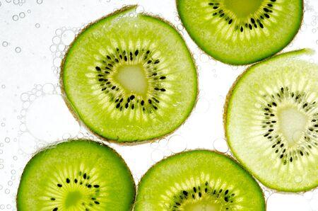 Slice kiwi fruit on white background Stock Photo - 12605083