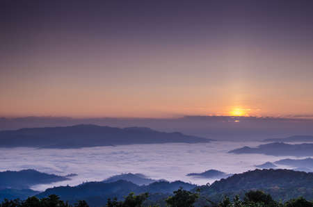 sunny side up: sun rise over a fog and mountain