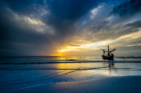 hua hin: Fishing boat with Beautiful sky on sunrise at Hua Hin Beach Thailand Stock Photo