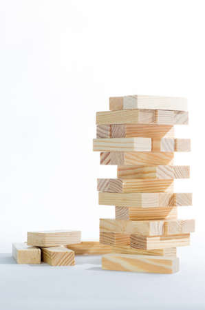 tower block: Wooden blocks tower isolated on white background