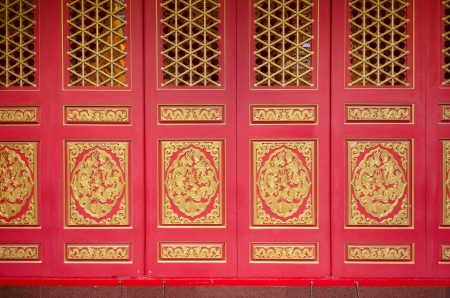 Red door with gloden dragon in Chinese temple photo