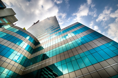 property management: Green glass modern business with Blue sky