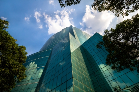disappeared: Green glass modern business with Blue sky