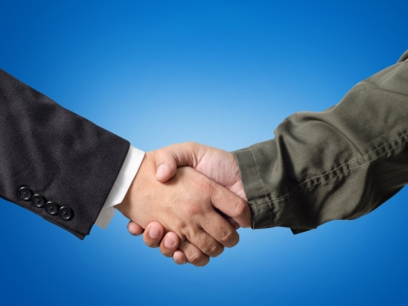 Business man and Engineer handshake Stock Photo