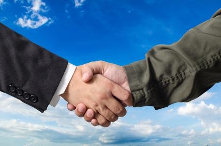 Business man and Engineer handshake on bluesky background