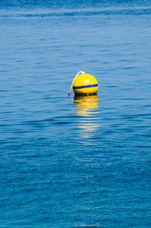 Yellow Buoy at sea Stock Photo - 18844452