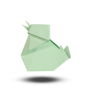 folded paper: origami chicken from paper on white background