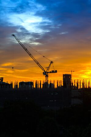 Industrial construction cranes and building silhouettes  photo