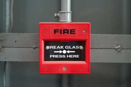 fire safety: Fire alarm box in factory Stock Photo
