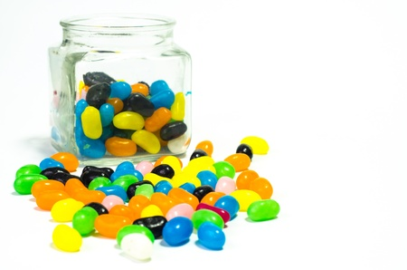 Jelly beans sugar candy snack in a jar isolated on white photo