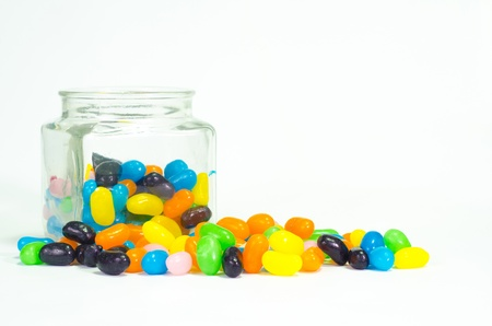 chew over: Jelly beans sugar candy snack in a jar isolated on white