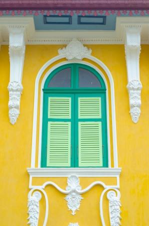 Beautifully Stucco facade windows.on yellow wall photo