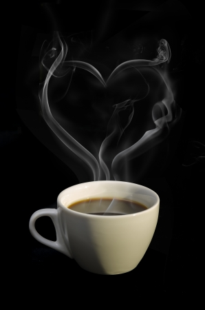 Cup of hot coffee with steam in LOVE on dark background