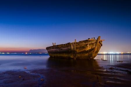 brighton beach:  Od boat on beach by sunset