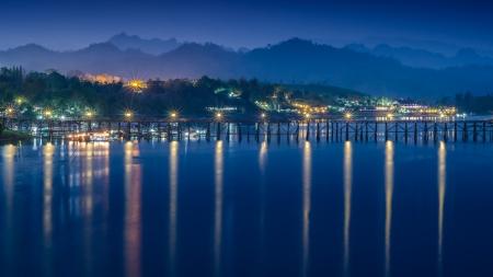 Long wooden bridge  in twilight, Sangklabur Thailand photo
