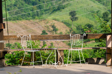 Two relaxing chairs overlooking peaceful mountain  photo