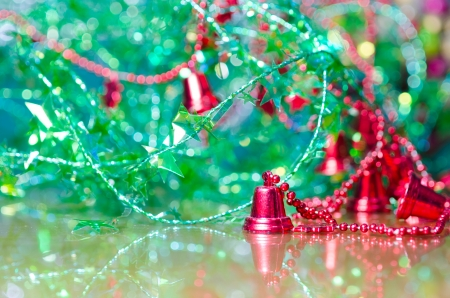 christmas decoration,red jingle bell against bokeh background photo