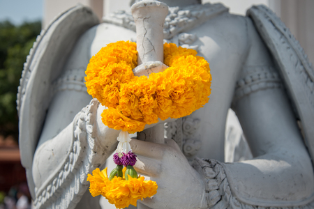 Flower on hand of Thai style sculpture art . photo
