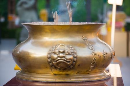 burning incense sticks in brass Incense bowl photo
