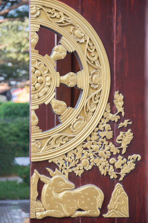 Traditional Chinese door with wood carve  photo