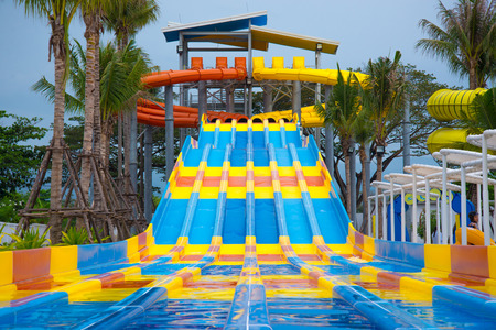 slipway: Slider in a variety of colors in the water park Stock Photo