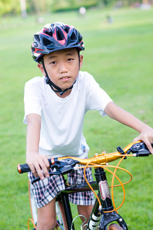 boy and bike in park photo