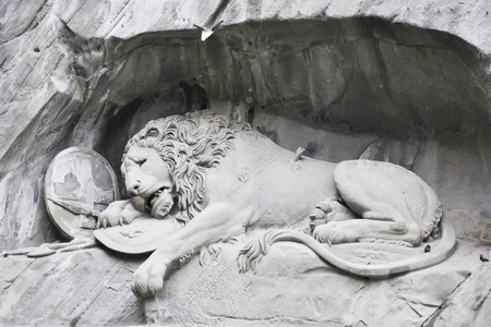 animal only: LUZERN, SWITZERLAND - APRIL 30,2011 : LUZERN dying lion monument closed up. The monument is a Swiss heritage of national significance. Editorial