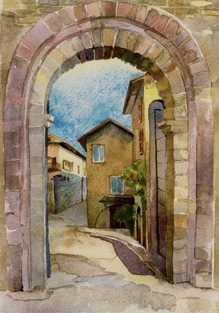 cobblestone street: stone gate in Assisi, Italy