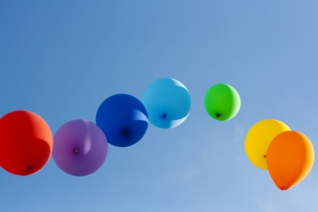 rainbow ballons in the sky photo