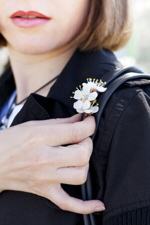 woman holding spring apricot flowers photo