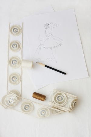 fashion design sketching with material examples photo