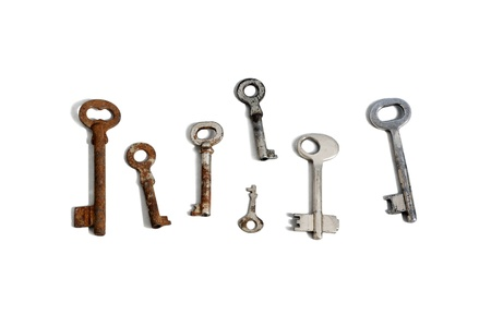 group of old fashioned rusty keys on white background Stock Photo