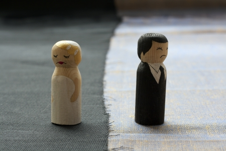 divorce: wife and husbend doodles in divorce process concept broken relationships