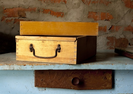 old fashioned wooden toolbox on the table in workshop photo