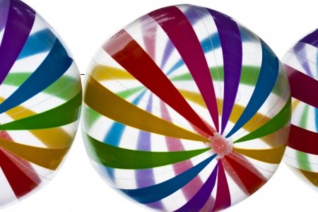 brightly colored: Transparent balloons with rainbow stripes into the sky Stock Photo