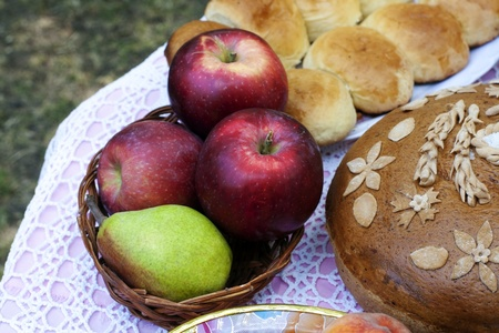 Rustic homemade still life with erd apple, pear in a basket and homemade bread Stock fotó