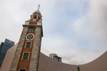 Old clock tower on Chim Sha Tsui, Kowloon, Hong Kong, China Stock Photo