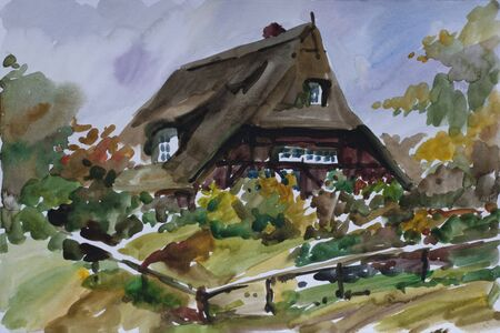 Rural landscape with old fachwerk house with straw roof and yard in autumn in Kiekeberg traditional architecture museum near Hamburg, Germany