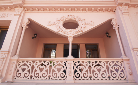 Unusual pink 19th century balcony with wooden banisters in downtown of Batumi, Georgia Editorial