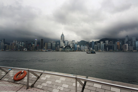 Hong Kong bay in a foggy day with dramatic sky Editorial