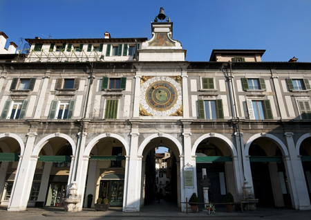 Main square in Brescia with belltower and ancient clock, Italy Stock Photo