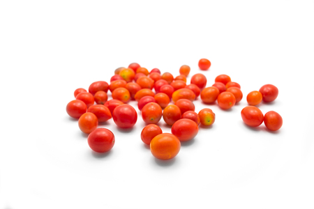 dispersed: Cherry tomatoes dispersed on white background