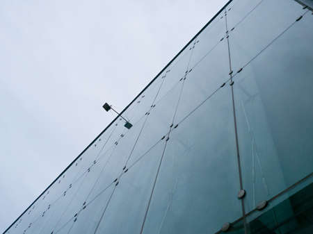 grey  sky: Building with mirror with grey sky background