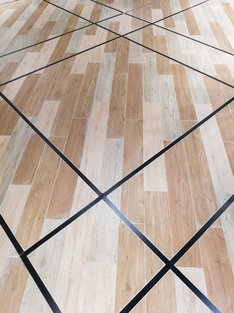leading: Earth tone wood parquet floor with leading line