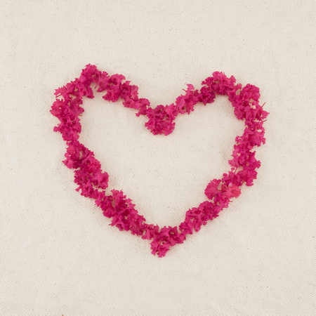 myrtle green: Heart shape pink crape myrtle petals wreath with copy space
