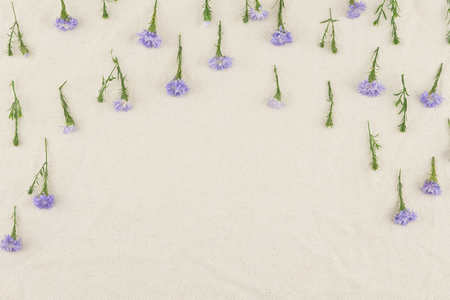 Purple cutter flowers pattern on white muslin fabric with copy space