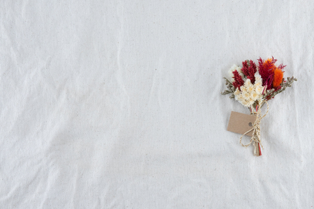 White and red flowers bouquet on white muslin fabric with copy space