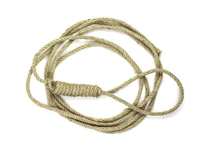 Roll of rope. Rope coiled in a circular pattern on white background. 免版税图像